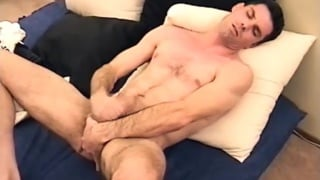 steve strokes his big uncut cock
