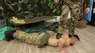 soldier forces captive to do pushups