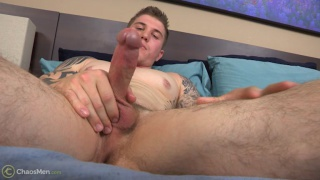 tatted beefy hunk strokes his cock