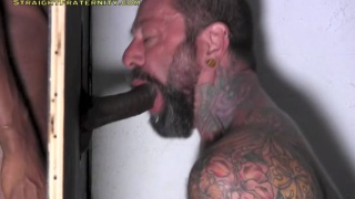 Tyler sticks his large black cock through glory hole
