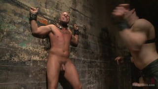 Jason Maddox works over Eli Hunter in the dungeon