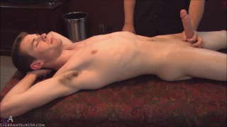 connor gets serviced on massage table