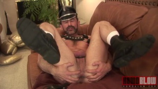 leather daddy jacks his cock