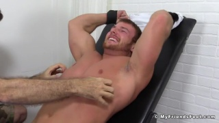 wrestler tied to a chair and tickled