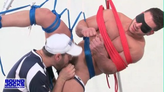 Knotty Brent tickles bound muscle jock