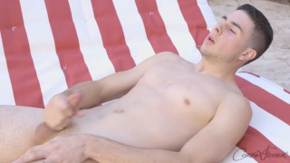 ETHAN UNLOADS his nuts poolside