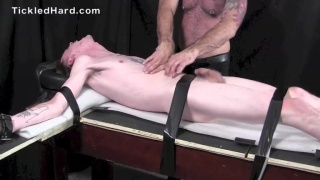 elijah is strapped to the tickling table and edged