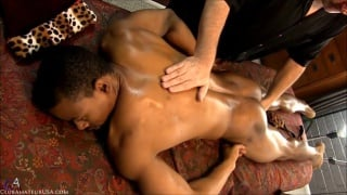 servicing black stud on the massage table