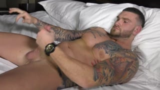tattooed hunk strokes his 9-inch dick