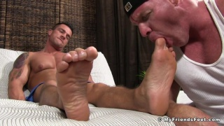 gym hunk sucks his buddy's toes after workout