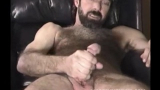 hairy hunky man Tim strokes his dick