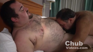 Hairy club men swapping blowjobs