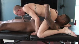 adam sucks nyja's hard black cock on massage table