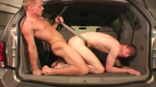 blond guy bangs ass in the back of a van