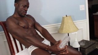 black guy shoves his big dick in a fleshlight