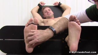 hunky Dane in the tickling chair