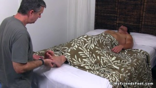 sleeping hunk gets his bare feet touched and licked