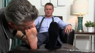 tall hunk in a suit gets bare feet worshipped
