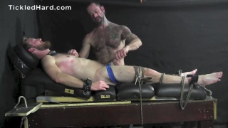 restrained ginger guy gets his dick milked