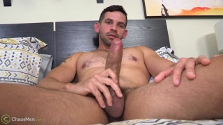 latino dude Hugo plays with his heavy-hanging cock