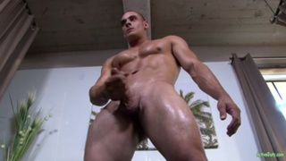 Max reclines on the couch and jerks his cock