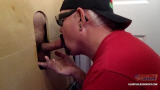 cock sucker works this dick at his glory hole
