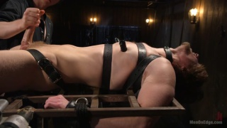 Captive Boy's Thick Cock Edged Mercilessly