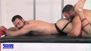 Bob Hager tops submissive Dolan Wolfe