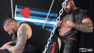 bearded hunk takes his master's cock in the sling