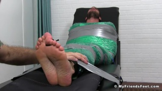 mummified Chase Lachance gets bare feet tickled