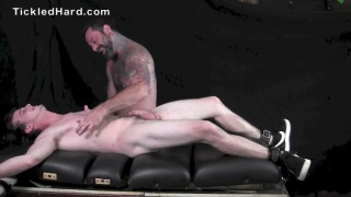 naked Donny Forza giggles while he's tickled