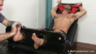 Blayne restrained in the tickling chair
