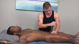 black guy gets stroked on massage table