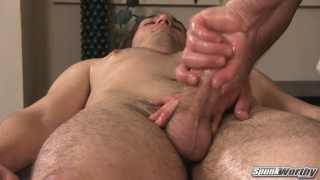 Brock gets his fat cock stroked during massage