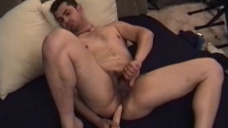 Andrew shoves a dildo up his ass