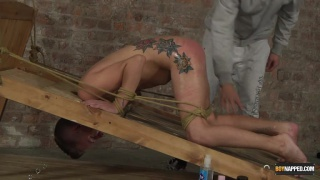 young slave boy tied to a bed ass up