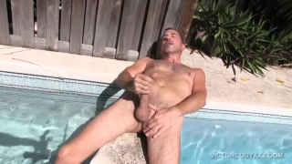 Victor Cody masturbates by the pool