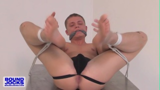 bound Micah Andrews jacks his cock
