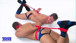 Brock Avery and Lucas Knight try untying each other
