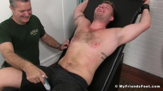 jake karhoff strapped into the tickling chair