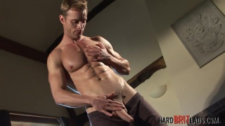 chiseled stud neil stevens jerks his massive cock