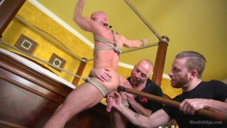 Mitch Vaughn tied up and edged by two guys