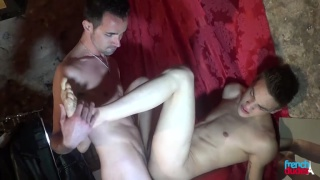two young guys have a good time in a back room