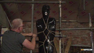 slave boy cocooned in plastic and edged