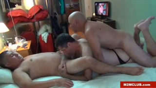 two chubby daddies share a horny bottom