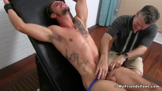 elijah squirms in the tickling chair