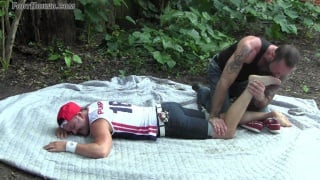muscle stud gets his bare feet worshipped outside