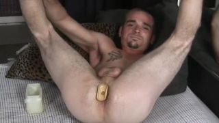 Eli Channing plays with dildo during JO session