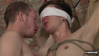 cute twink blindfolded and roped to a cross