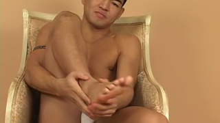 Go-Go boy plays with his feet